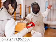 Купить «Fencers exercising techniques in battle», фото № 31957656, снято 11 июля 2018 г. (c) Яков Филимонов / Фотобанк Лори