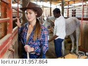 Купить «Woman who works at stable», фото № 31957864, снято 2 октября 2018 г. (c) Яков Филимонов / Фотобанк Лори
