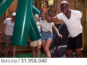 Купить «People passing horizontal bar at adventure park», фото № 31958040, снято 23 января 2020 г. (c) Яков Филимонов / Фотобанк Лори