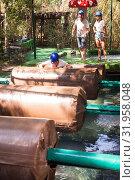 Купить «Team of friends overcomes an obstacle course in an amusement park», фото № 31958048, снято 25 августа 2019 г. (c) Яков Филимонов / Фотобанк Лори
