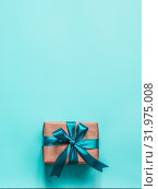 Gift box in craft paper and satin ribbon. Стоковое фото, фотограф Ольга Сергеева / Фотобанк Лори