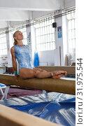 Купить «Sporty female acrobat in bodysuit practice new techniques at bars», фото № 31975544, снято 18 июля 2018 г. (c) Яков Филимонов / Фотобанк Лори