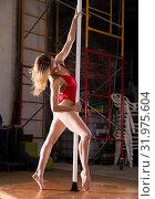 Купить «Sexy dance of a beautiful woman in red swimsuit on a pylon», фото № 31975604, снято 16 сентября 2019 г. (c) Яков Филимонов / Фотобанк Лори