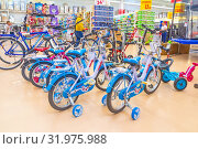 Купить «Russia, Samara, March 2019: Sale of children's bicycles dumplings in the network hypermarket. Text in Russian: discounts», фото № 31975988, снято 5 мая 2019 г. (c) Акиньшин Владимир / Фотобанк Лори
