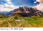 Aerial top view from drone to wonderful alpine landscape and meadows at Pass Gardena with majestic Sella mountain group in Dolomiti. Alps, South Tirol, Dolomites mountains, passo di Val Gardena, Italy. Стоковое фото, фотограф Алексей Ширманов / Фотобанк Лори
