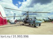 Купить «ZHUKOVSKY, RUSSIA - JULY 20, 2017: Russian reconnaissance and attack helicopter Ka-52 on the MAKS-2017 air show», фото № 31993996, снято 20 июля 2017 г. (c) Виктор Карасев / Фотобанк Лори