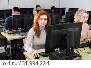Купить «Mature woman during computer classes», фото № 31994224, снято 20 февраля 2019 г. (c) Яков Филимонов / Фотобанк Лори