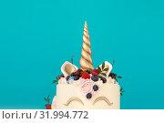 Купить «Unicorn cake with copy space to side», фото № 31994772, снято 19 июля 2019 г. (c) Ekaterina Demidova / Фотобанк Лори
