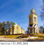 Beautiful view of ancient Lutheran Church whith bell tower in kerimaki of southern Savo province on a sunny spring day. The biggest wooden cathedral in Scandinavia and in the world. Eastern Finland (2019 год). Стоковое фото, фотограф Алексей Ширманов / Фотобанк Лори