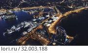 Купить «View from drone of illuminated Barceloneta beach with Port Vell t night», видеоролик № 32003188, снято 26 марта 2019 г. (c) Яков Филимонов / Фотобанк Лори