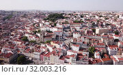 Купить «Aerial view of historical centre of Lisbon overlooking medieval Roman Catholic Cathedral and Castle of Sao Jorge, Portugal», видеоролик № 32003216, снято 20 апреля 2019 г. (c) Яков Филимонов / Фотобанк Лори