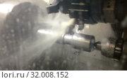 Купить «The lathe with the CNC processes a cutter a steel detail. In processing of a detail cooling liquid is used», видеоролик № 32008152, снято 7 августа 2009 г. (c) Куликов Константин / Фотобанк Лори