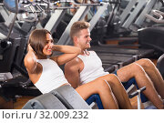Купить «man and woman making sit ups together using machine in gym», фото № 32009232, снято 4 октября 2016 г. (c) Яков Филимонов / Фотобанк Лори