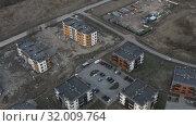 Купить «aerial photography of new buildings with equipped territory and a playground», видеоролик № 32009764, снято 5 июня 2019 г. (c) Aleksandr Sulimov / Фотобанк Лори