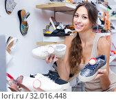 Купить «young woman in shoes store», фото № 32016448, снято 22 августа 2019 г. (c) Яков Филимонов / Фотобанк Лори