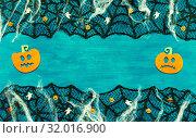 Купить «Halloween background with spider web, spiders and smiling jack decorations as symbols of Halloween on the dark green wooden background. Halloween concept», фото № 32016900, снято 8 октября 2018 г. (c) Зезелина Марина / Фотобанк Лори