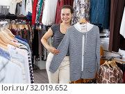 Купить «Woman choosing new clothes in showroom», фото № 32019652, снято 10 октября 2018 г. (c) Яков Филимонов / Фотобанк Лори