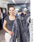 Купить «Woman shopping in outerwear clothing boutique», фото № 32019672, снято 10 октября 2018 г. (c) Яков Филимонов / Фотобанк Лори