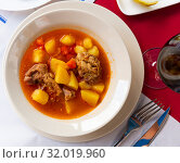 Купить «Delicious lamb soup with potatoes. Traditional oriental dish», фото № 32019960, снято 21 сентября 2019 г. (c) Яков Филимонов / Фотобанк Лори