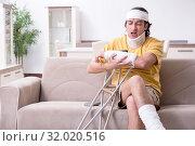 Купить «Young man after accident recovering at home», фото № 32020516, снято 3 мая 2019 г. (c) Elnur / Фотобанк Лори