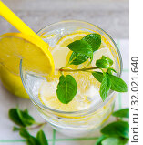 Купить «Glasss of mojito with lemon and drinking straw», фото № 32021640, снято 22 ноября 2017 г. (c) Elnur / Фотобанк Лори