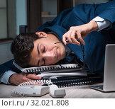 Купить «Businessman working overtime long hours late in office», фото № 32021808, снято 9 октября 2017 г. (c) Elnur / Фотобанк Лори