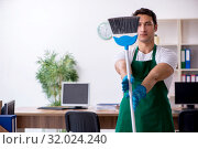 Купить «Young handsome contractor cleaning the office», фото № 32024240, снято 9 мая 2019 г. (c) Elnur / Фотобанк Лори