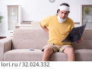Купить «Young man after accident recovering at home», фото № 32024332, снято 3 мая 2019 г. (c) Elnur / Фотобанк Лори