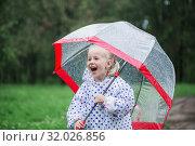 funny little girl with umbrella in rain. Стоковое фото, фотограф Майя Крученкова / Фотобанк Лори