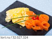 Купить «Omelet with smoked salmon», фото № 32027324, снято 22 сентября 2019 г. (c) Яков Филимонов / Фотобанк Лори