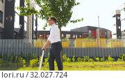 Купить «young businessman riding electric scooter outdoors», видеоролик № 32027724, снято 5 августа 2019 г. (c) Syda Productions / Фотобанк Лори