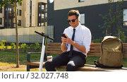 Купить «businessman with cellphone, headphones and scooter», видеоролик № 32027748, снято 5 августа 2019 г. (c) Syda Productions / Фотобанк Лори
