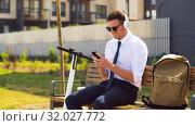 Купить «businessman with cellphone, headphones and scooter», видеоролик № 32027772, снято 5 августа 2019 г. (c) Syda Productions / Фотобанк Лори