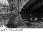Купить «City river with a fragment of a bridge, monochrome photo», фото № 32027988, снято 11 августа 2019 г. (c) Евгений Харитонов / Фотобанк Лори