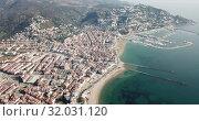 Купить «View from drone of famous tourist town of Roses on Catalan coast of Gulf of Roses with yachts in marina, Catalonia, Spain», видеоролик № 32031120, снято 10 февраля 2019 г. (c) Яков Филимонов / Фотобанк Лори