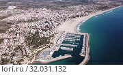 Купить «Picturesque aerial view of Mediterranean coastal town of Torredembarra with yachts moored in harbor, Tarragona, Spain», видеоролик № 32031132, снято 18 марта 2019 г. (c) Яков Филимонов / Фотобанк Лори