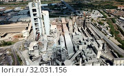 Купить «Industrial background with large cement factory. Aerial view», видеоролик № 32031156, снято 26 августа 2018 г. (c) Яков Филимонов / Фотобанк Лори