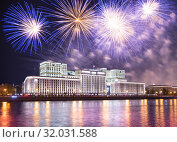 Купить «Main Building of the Ministry of Defence of the Russian Federation-- is the governing body of the Russian Armed Forces and celebratory colorful fireworks exploding in the skies. Moscow, Russia», фото № 32031588, снято 9 мая 2019 г. (c) Владимир Журавлев / Фотобанк Лори