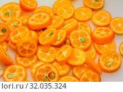 Купить «Tray full of ripe kumquat slices, suitable as background», фото № 32035324, снято 13 ноября 2019 г. (c) easy Fotostock / Фотобанк Лори