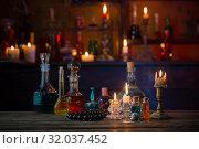 Купить «magic potions in bottles on wooden table», фото № 32037452, снято 14 августа 2019 г. (c) Майя Крученкова / Фотобанк Лори
