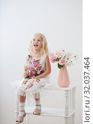 Купить «beautiful little blonde girls with flowers on white background», фото № 32037464, снято 15 августа 2019 г. (c) Майя Крученкова / Фотобанк Лори