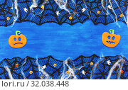 Купить «Halloween background withsSpider web, spiders and smiling jack decorations as symbols of Halloween on the dark green wooden background. Halloween festive concept», фото № 32038448, снято 8 октября 2018 г. (c) Зезелина Марина / Фотобанк Лори