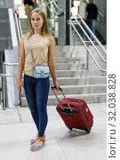 Купить «Girl walking with baggage in metro», фото № 32038828, снято 19 сентября 2018 г. (c) Яков Филимонов / Фотобанк Лори