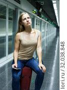 Купить «Tired woman waiting subway», фото № 32038848, снято 19 сентября 2018 г. (c) Яков Филимонов / Фотобанк Лори