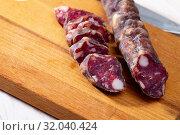Купить «Sliced french dry sausage», фото № 32040424, снято 21 августа 2019 г. (c) Яков Филимонов / Фотобанк Лори