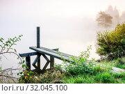 Купить «Footbridge at the lake with fog in the morning», фото № 32045100, снято 10 апреля 2020 г. (c) easy Fotostock / Фотобанк Лори