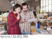 Купить «Team of aircraft enthusiasts checking drawings», фото № 32052380, снято 4 марта 2019 г. (c) Яков Филимонов / Фотобанк Лори