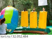 Купить «Fine adults dressed in large inflatable pasta», фото № 32052484, снято 23 октября 2019 г. (c) Яков Филимонов / Фотобанк Лори