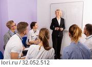 Купить «Female speaker giving presentation for students in lecture hall», фото № 32052512, снято 5 октября 2017 г. (c) Яков Филимонов / Фотобанк Лори