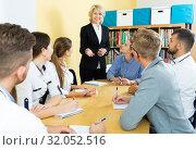 Купить «group of students listening teacher», фото № 32052516, снято 5 октября 2017 г. (c) Яков Филимонов / Фотобанк Лори